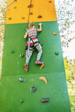 Little girl talking trains on climbing wall Royalty Free Stock Image