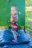 Little girl talking trains on climbing wall Stock Photos
