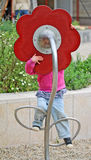 Little girl talks into flower microphone Royalty Free Stock Images