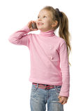 Little girl talks by mobile phone. Isolated on white Royalty Free Stock Image