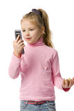 Little girl talks by mobile phone. Isolated on white Stock Photo