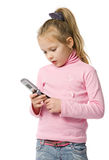 Little girl talks by mobile phone. Isolated on white Stock Image