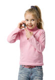 Little girl talks by mobile phone. Isolated on white Stock Photos