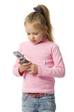 Little girl talks by mobile phone. Isolated on white Royalty Free Stock Images
