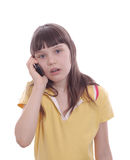 The little girl talks by a mobile phone. Surprise Stock Images