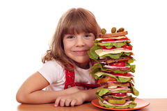 Little girl and tall sandwich Stock Photography