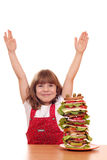 Little girl with tall sandwich Stock Images