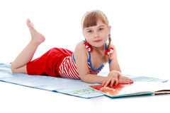 Little girl tans Royalty Free Stock Photos