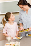 Little girl taste baked cupcakes with mum Royalty Free Stock Photo