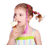 Little girl taste ice cream Stock Image
