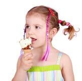 Little girl taste ice cream Stock Image