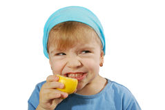 Little girl taste lemon Royalty Free Stock Image