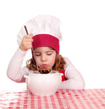 Little girl taste soup royalty free stock photos