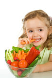 Little girl tasting and chomping a carrot Stock Image
