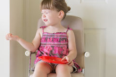 Little girl tasting food and making funny face stock images