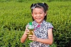 The little girl in the tea garden Royalty Free Stock Photo
