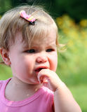 Little Girl Tears. An unhappy little girl sits crying on a warm summer day Royalty Free Stock Photos