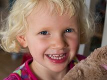 Little girl with teddy bear Stock Photo