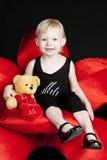 Little girl with a teddy bear Stock Photo