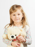 Little girl with a teddy bear Royalty Free Stock Photos