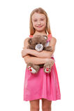 Little girl with teddy bear. Stock Images