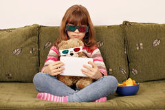Little girl and teddy bear with 3d glasses Royalty Free Stock Images