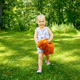 Little girl with teddy bear Royalty Free Stock Photography