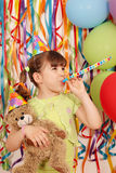 Little girl with teddy bear birthday party Stock Images