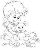 Little girl and Teddy bear Stock Photography