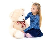 Little girl with teddy bear. Little girl with a teddy bear. The concept of the game, raising a child in kindergarten and in the family. Isolated on white royalty free stock images