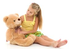 Little girl with teddy bear. Little girl with a teddy bear. The concept of the game, raising a child in kindergarten and in the family. Isolated on white royalty free stock photos