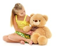 Little girl with teddy bear. Little girl with a teddy bear. The concept of the game, raising a child in kindergarten and in the family. Isolated on white stock photo