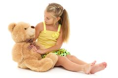 Little girl with teddy bear. Little girl with a teddy bear. The concept of the game, raising a child in kindergarten and in the family. on white background royalty free stock photos