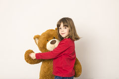Little Girl And Teddy Bear Royalty Free Stock Photography