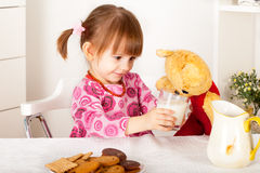 Little girl with teddy bear Stock Photos