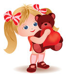 Little girl with teddy bear and heart. Royalty Free Stock Photography