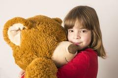 Little Girl And Teddy Bear Royalty Free Stock Photos