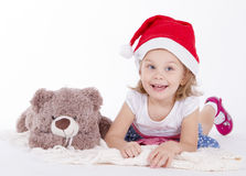 Little girl and teddy bear lying Royalty Free Stock Image
