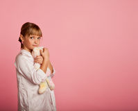 Little girl with a teddy bear Stock Photos