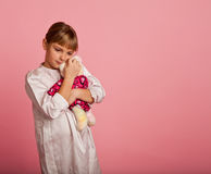 Little girl with a teddy bear Royalty Free Stock Images