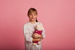Little girl with a teddy bear Royalty Free Stock Photography