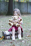 Little girl with Teddy Bear outside stock photography