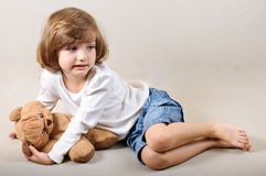 Little girl with teddy bear portrait Stock Photography
