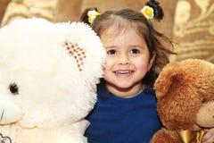 Little girl and teddy bear Stock Image