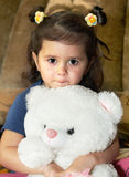 Little girl and teddy bear Royalty Free Stock Images