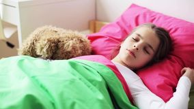 Little girl with teddy bear sleeping at home stock video footage