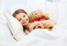 Little girl with teddy bear sleeping at home Royalty Free Stock Photo