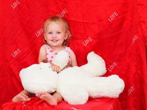 Little girl and teddy bear Stock Photography