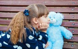 Little girl with teddy bear Stock Photography