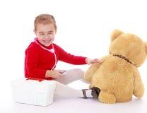 Little girl Teddy bear treats stock image